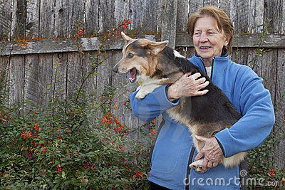 Old woman with corgi puppy