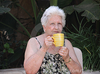 Old woman drinking tea