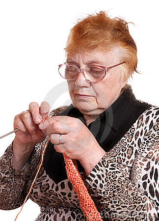 The old woman is engaged in knitting