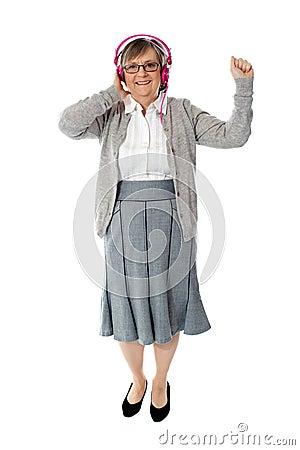 Old woman enjoying music