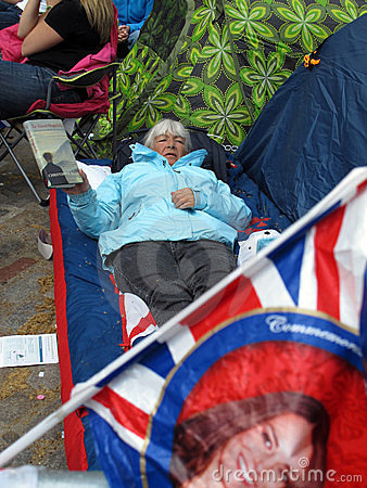 Old woman in fan camp Editorial Image