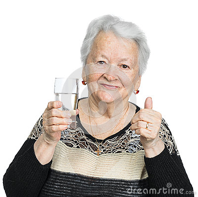 Old woman with glass of water Stock Photo