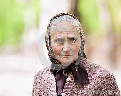 Old woman with kerchief outdoor
