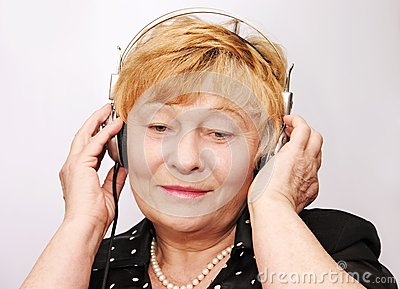 Old woman listens to music