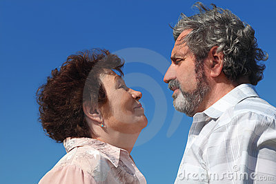 Old woman and man looking to each other