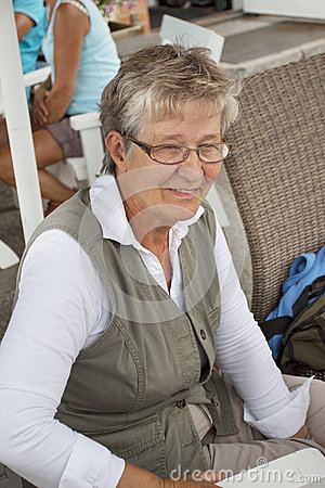 Old woman in outdoor restaurant