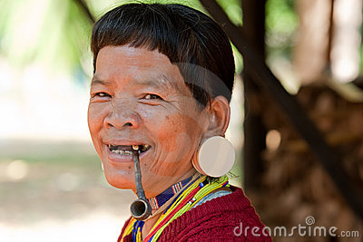 Old woman with pipe in Asia Editorial Photography