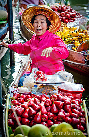 Old woman selling fruit in bangkok floating market Editorial Stock Image