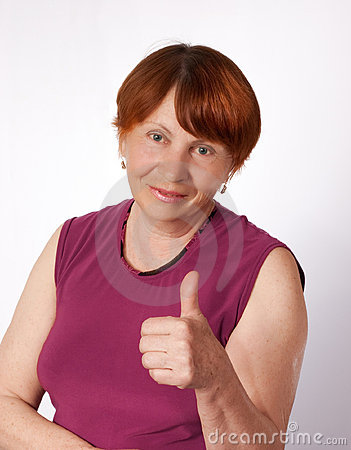 Old woman shows thumb
