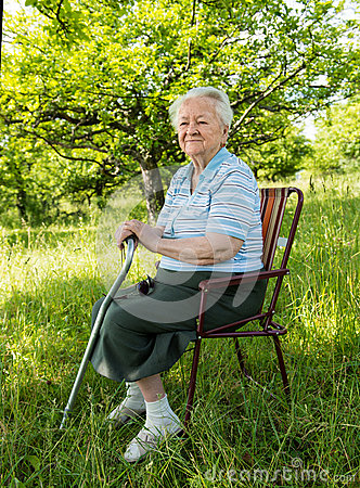Free Old Woman Sitting On A Chair Stock Image - 31634671
