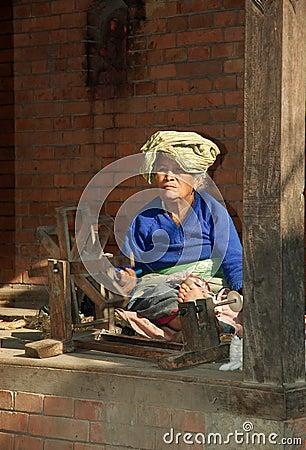 Old woman spinning wool,Kathmandu,Nepal Editorial Stock Photo