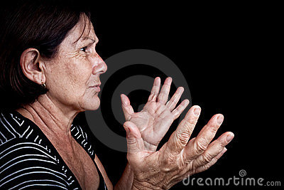 Old woman talking  and gesturing with her hands