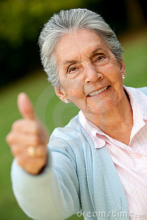 Old woman with thumbs up