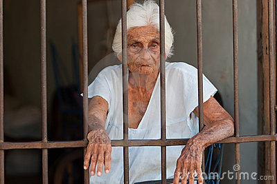 Old woman trapped behind bars editorial photography image 18332287