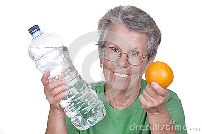 Old woman with water bottle and orange
