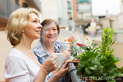 Old women on balcony with tea