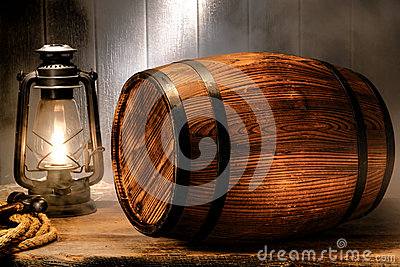 Old Wood Antique Whisky Barrel in Smoky Warehouse
