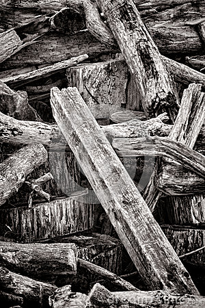 Old Wood Beam Post in Pile of Discarded Trash Wood