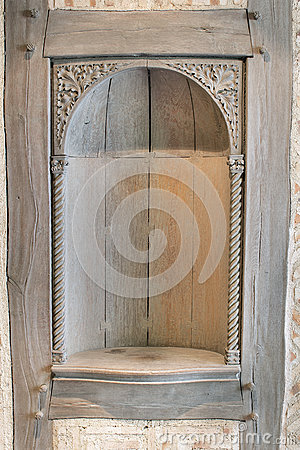 Old wood carved exterior wall niche royalty free stock for Time saver details for exterior wall design