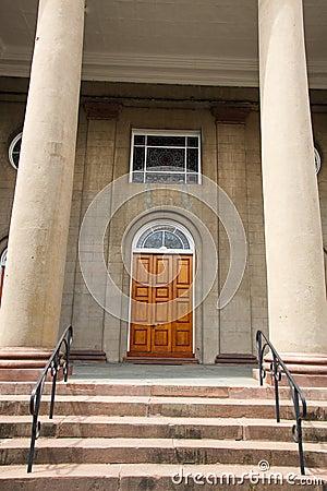 Free Old Wood Door Between Columns Royalty Free Stock Photography - 29621167