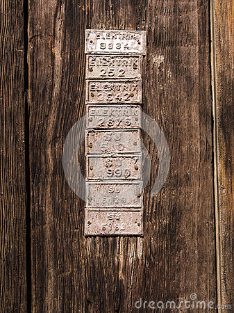 Old Wood Door Detail with Plates on It