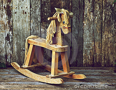 Old wood rocking horse on wood.