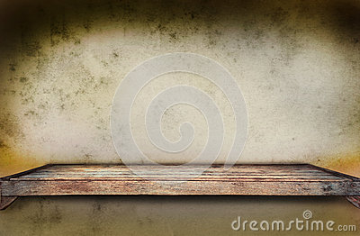 Old wood shelf on grungy wall