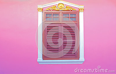 Old wood windows on pink