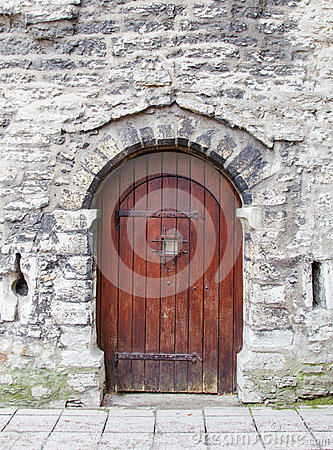 Old wooden arched door
