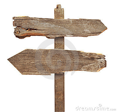 Old wooden arrows road sign