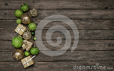Old wooden background with christmas decoration in apple green a Stock Photo