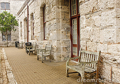 Old Wooden Benches Along Stone Block Wall