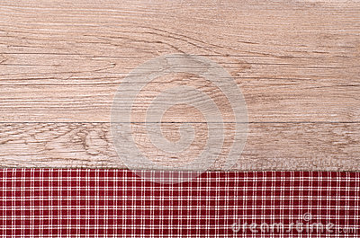Old wooden board with checkered cloth