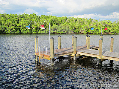 Old wooden boat dock by an inlet