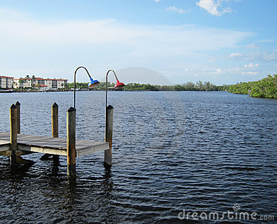 Old wooden boat dock by an inlet in Naples Florida