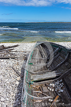 Old wooden boat on the seashore