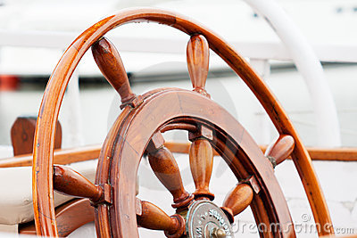 Old wooden boat wheel
