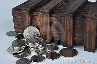 Old wooden box and coins