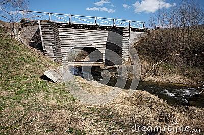 Old wooden bridge in Ferapontovo, Russia