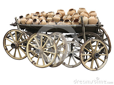 Old wooden cart full of clay pottery and wheels isolated over wh