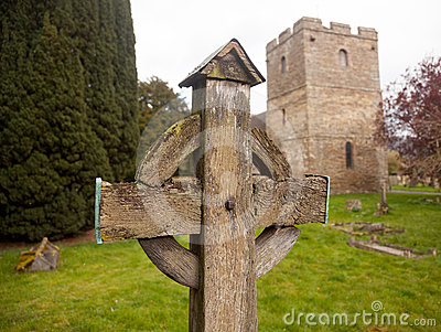 Old wooden cross in Stokesay graveyard