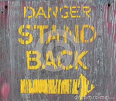 Old wooden danger sign.