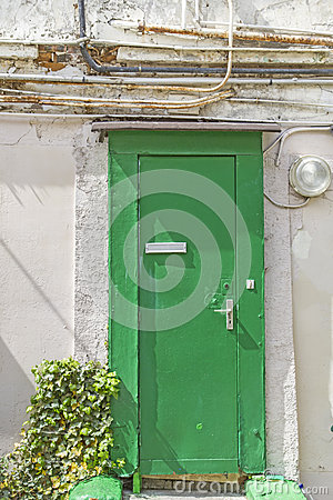 Old wooden door with electrical cables