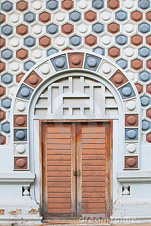Old wooden door and pattern wall of brick