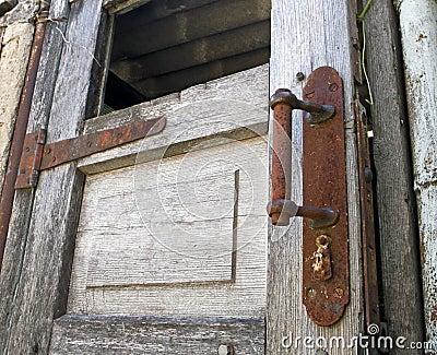 Old wooden door with rusty knob
