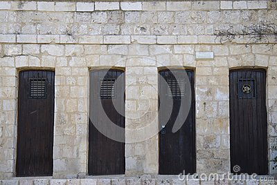Old wooden doors in stone wall