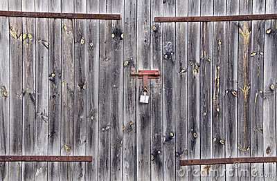 Old wooden farm rural building door locked padlock