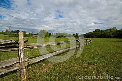 Old wooden fence in meadow