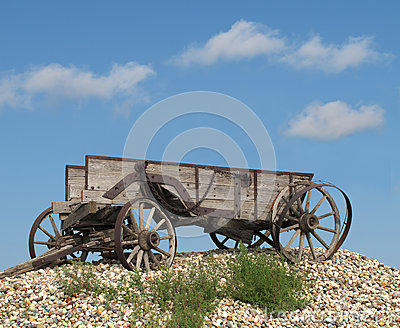Old wooden horse-drawn farm wagon.
