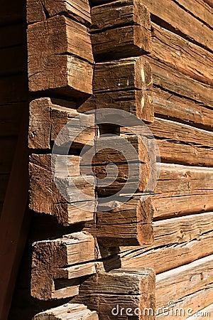 Old wooden log house corner